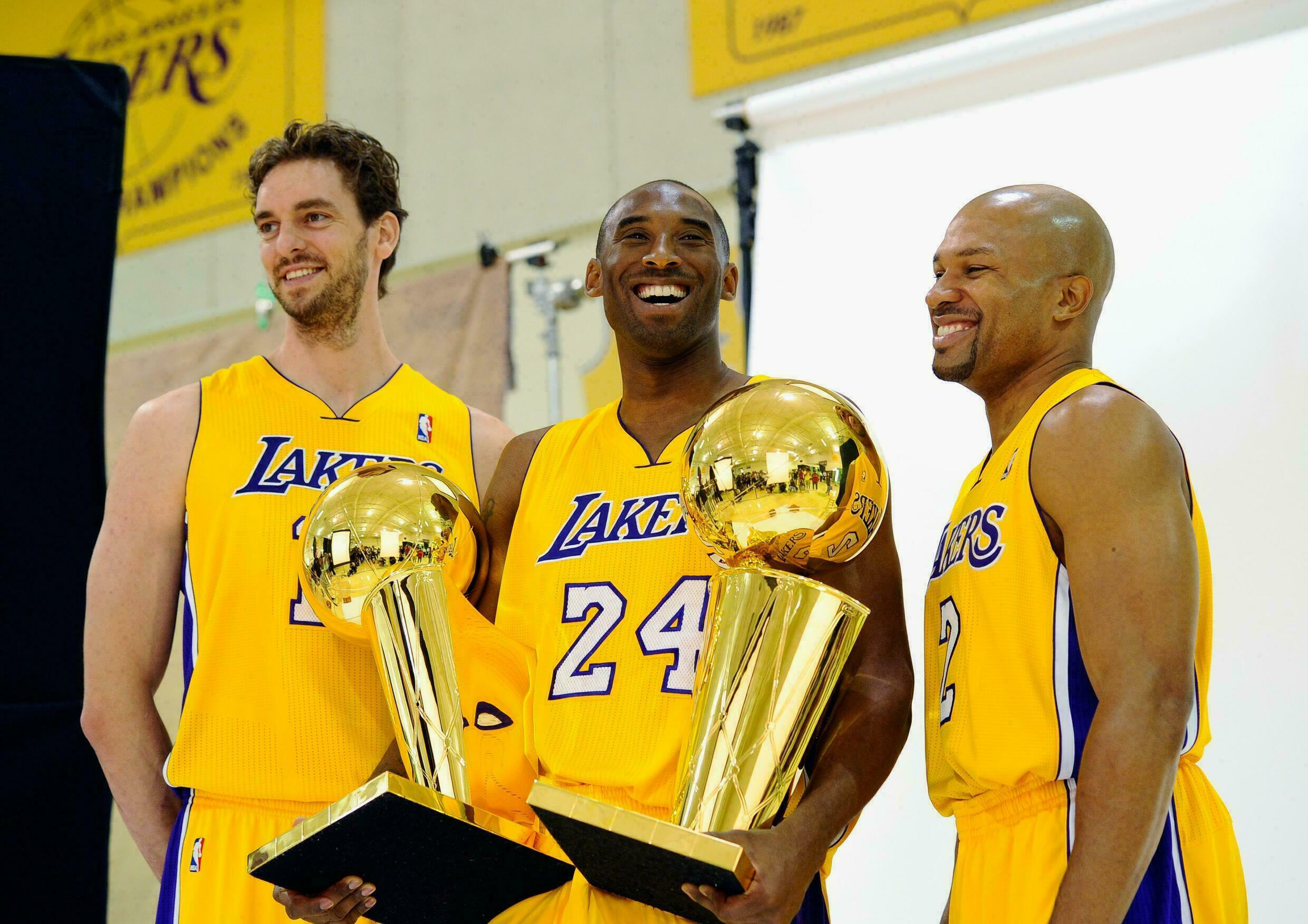 Pau Gasol alongside Kobe Bryant and Derek Fisher after the NBA title won by the Los Angeles Lakers in 2010.